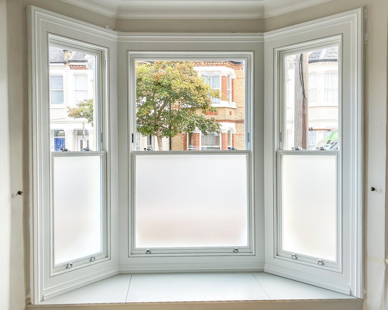 Timber sash bay window with satinovo glass for privacy