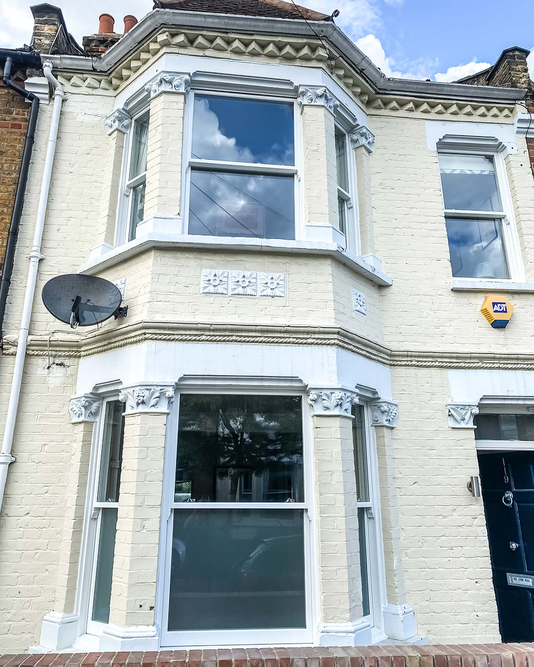 London home exterior with traditional timber sash windows