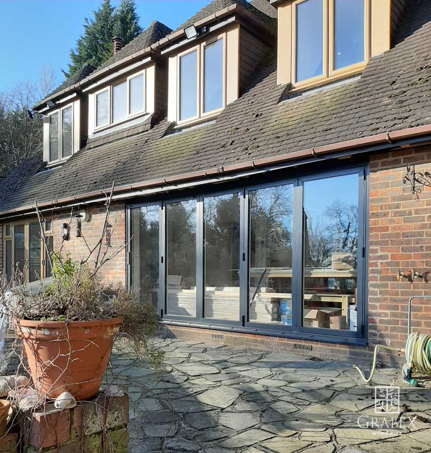 Back of the House with CF68 Aluminium Bi-folding Doors from Grabex Windows