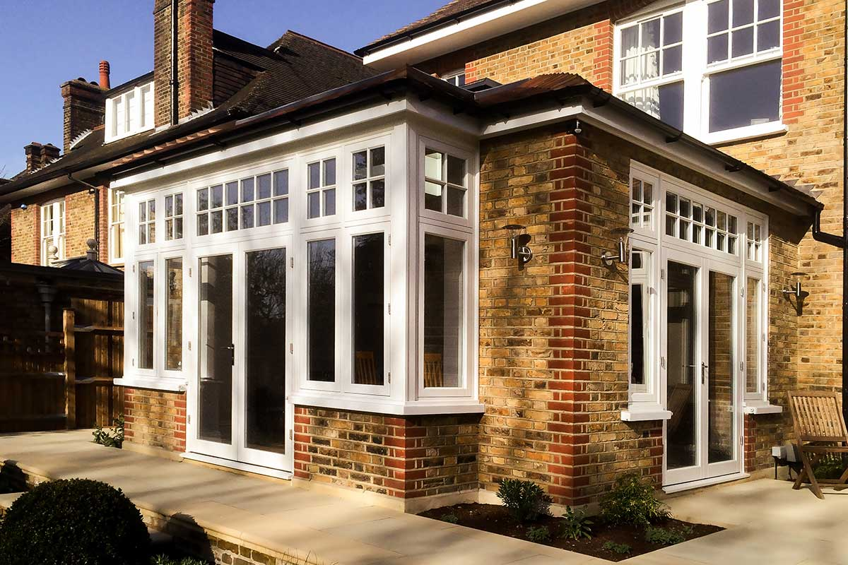 Yellow Brick extension with White timber French door from Grabex Windows