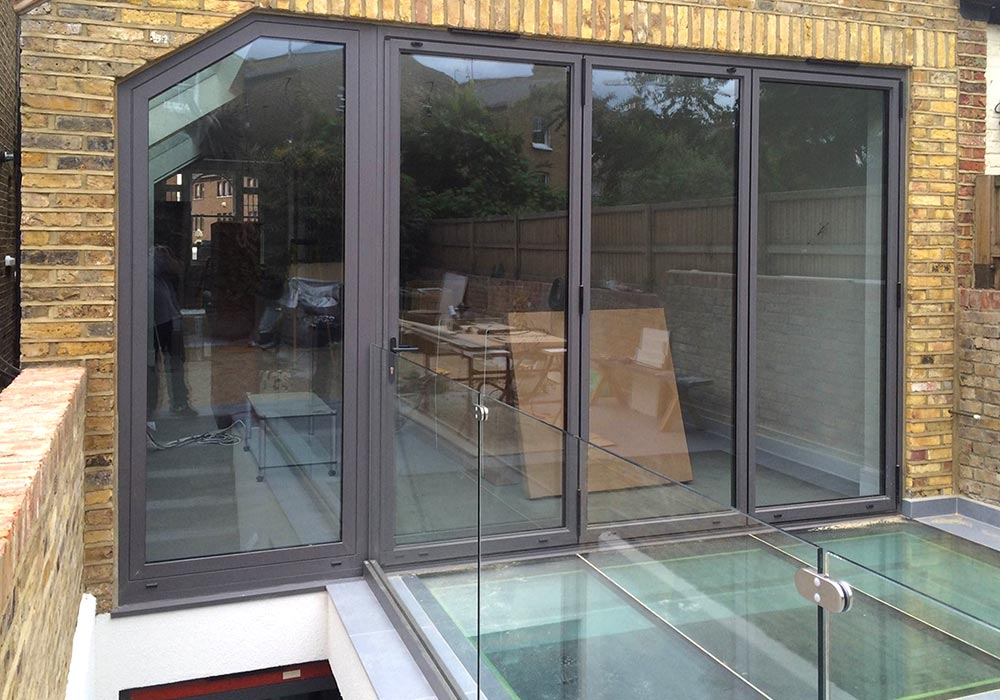 Cf77 Aluminium Bifolding Doors And Walk On Glass