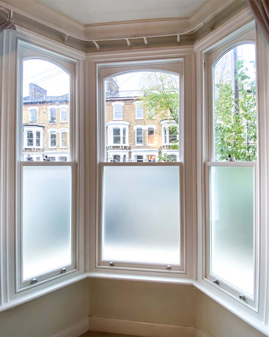 Timber Sash Window Bay with arched sash and privacy glass
