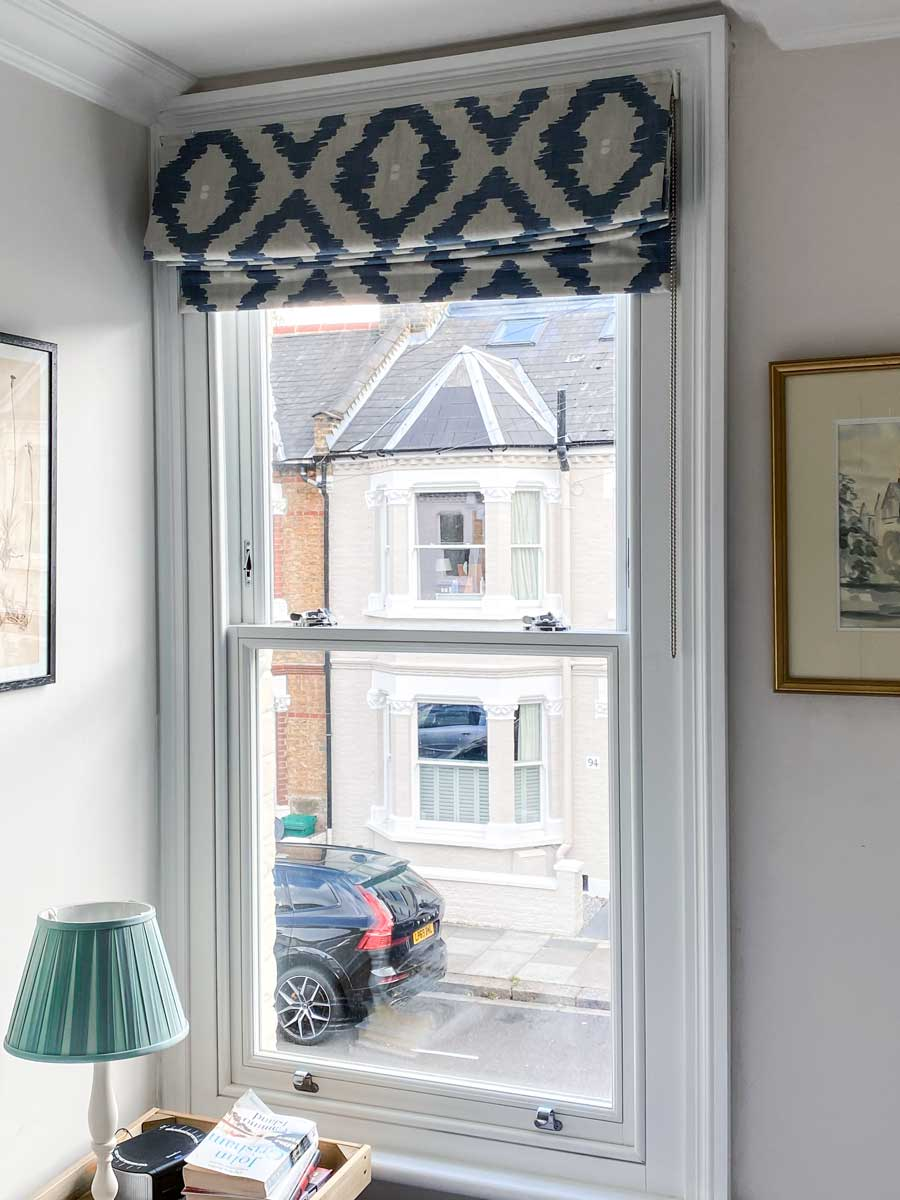 Traditional timber sash window with architraves - view from inside of the London flat